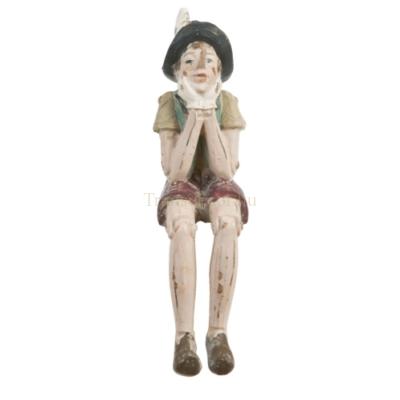 Clayre & Eef 6PR0149KL Dekor Pinokkió figura 4x7x15cm,ülő-könyöklős